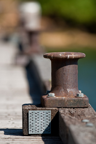 A bollard on the dockside.
