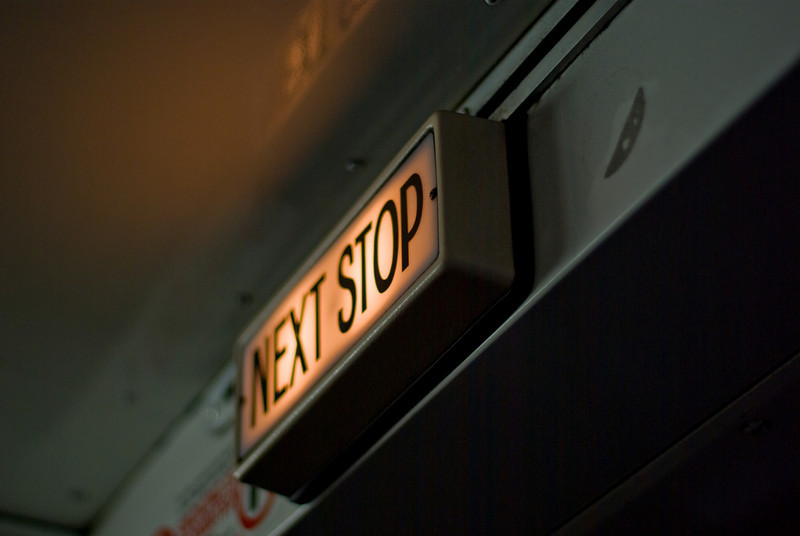 "A sign showing ""Next Stop"" in a bus.<br /> <br /> Images was shot using available light at f/1.4, hence the paperthin depth of field."