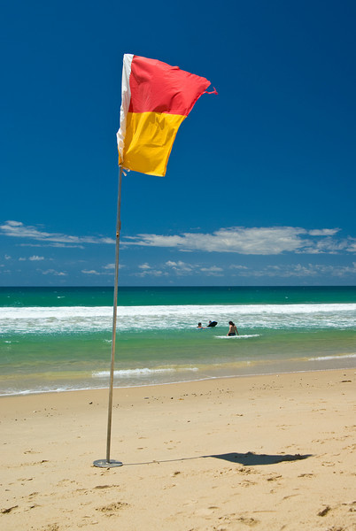 Red and Yellow Lifeguard flag on Currimundi Beach, Queensland, Australia