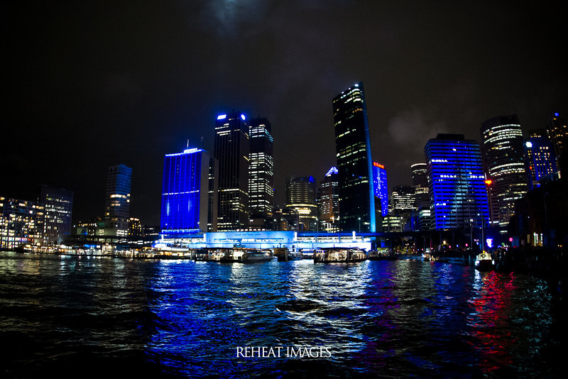 Blue reflects the weather at Vivid Sydney in this scene of the Circular Quay skyline.