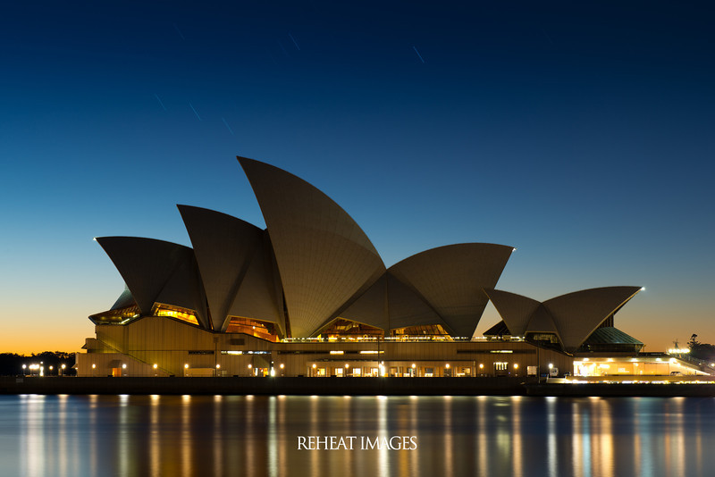 Sydney Opera House at 6:00am in the morning, exposed for 180 seconds at F/14 with ISO50 from the Nikon D800e. The long exposure shows the movement of stars and also begins to show the sun rising from the east, mixing the warm colour of the sun with the cool shades of night. Utilised a Nikon D800e with AF-S Nikkor 24-70mm F/2.8G ED lens mounted on Manfrotto 055X ProB tripod with 808RC4 head and a remote release to control the exposure (bulb mode).
