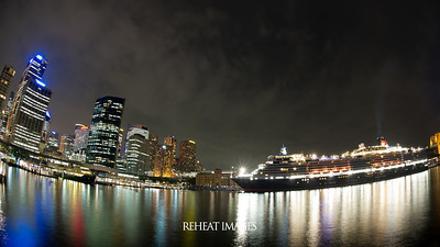 Cunard Queen Elizabeth docked in Sydney Harbour at night.