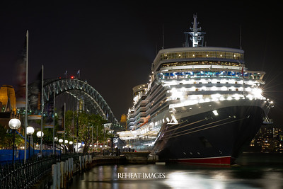 Cunard Queen Elizabeth docked in Sydney Harbour at night.