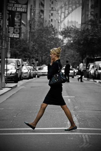 A woman crossing a road in the Sydney CBD