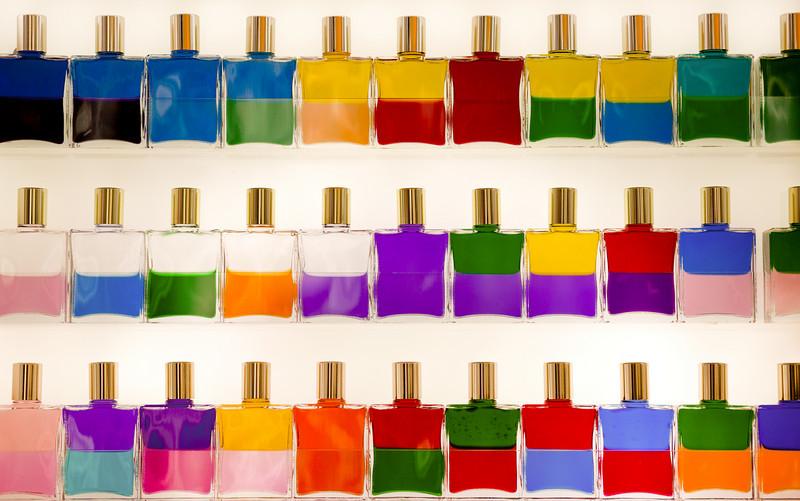Backlit bottles of coloured oils