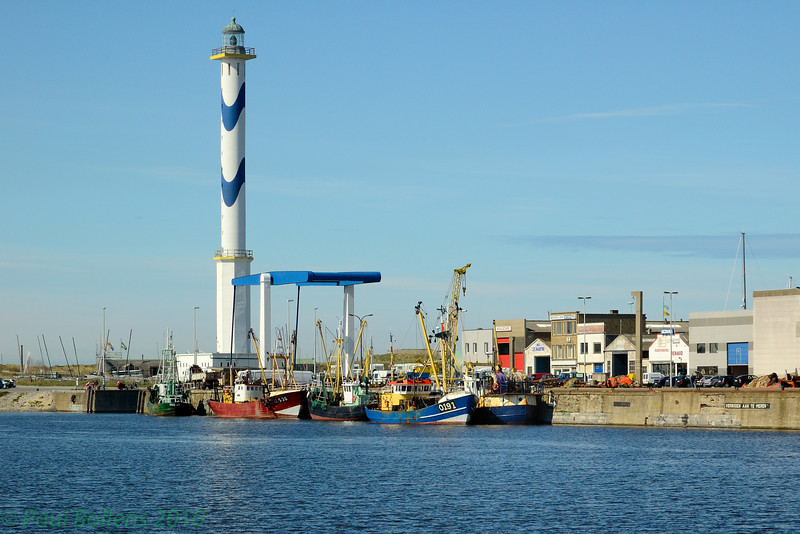 Lighthouse and fishing vessels