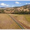 Blue Pipeline Across Farmland