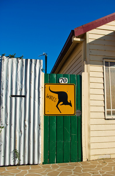 A gate to a house in Main Street, Wallerawang NSW, with a yellow kangaroo sign - Reprocessed image