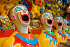 Colourful Laughing Clowns at an Amusement Park