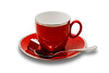 An Empty Red Teacup and Saucer With Teabag Isolated on White with Clipping Path