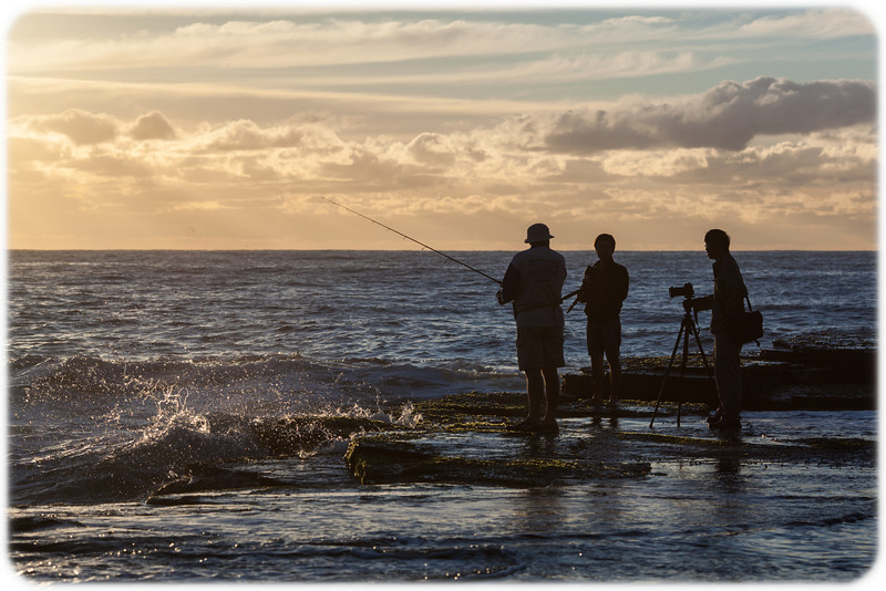 Photographers Chatting to a Fisherman