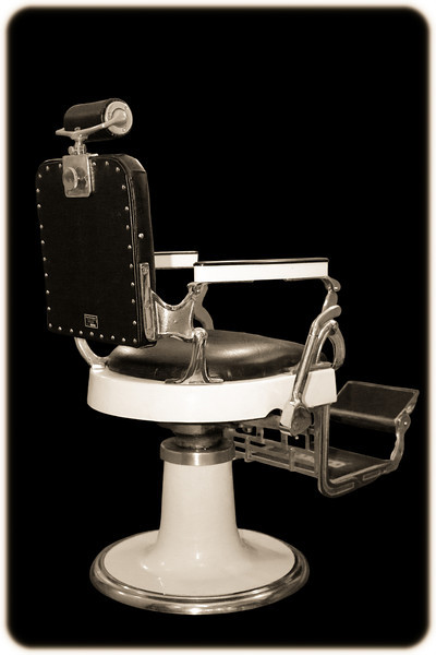 Sepia-toned Antique Barber's Chair Isolated on Black