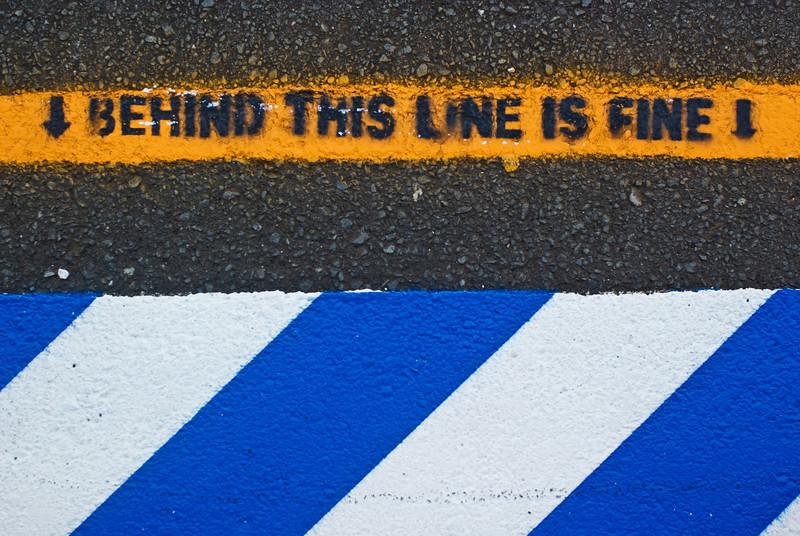 A safety warning on a railway platform