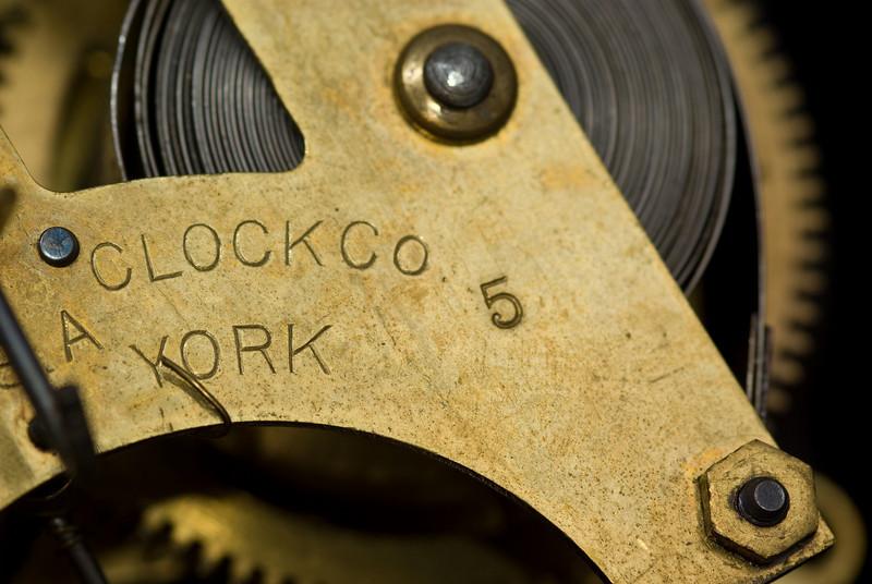 A macro shot of a antique (1881) clock movement