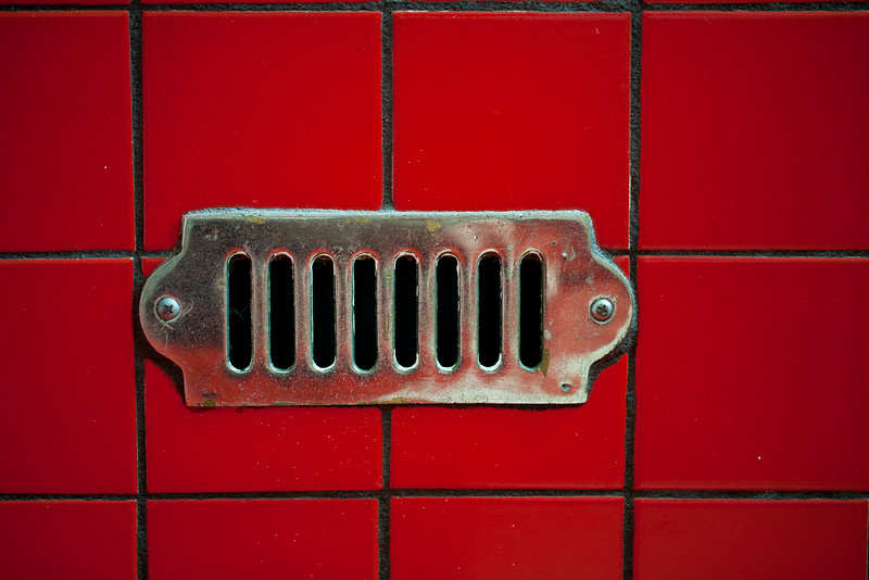 Vent in the Side of a Red Tiled Bath