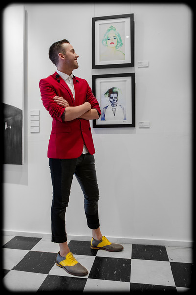Artist Jesse Wakenshaw with some of his work at QueerSpace Gallery in Darlinghurst