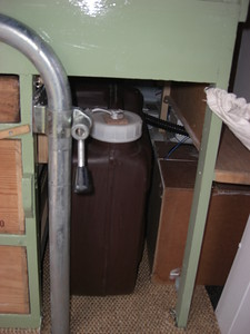 Brown removable (for filling) freshwater container.Brown box to the right contains the gas cylinder and gas detector