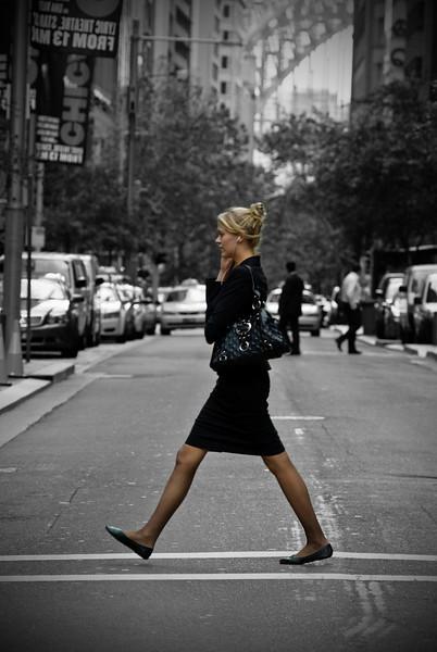 A woman crossing a road in the Sydney CBD
