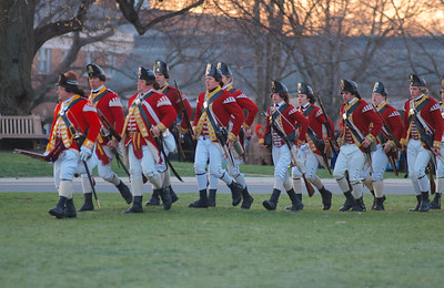 041513, Lexington, MA - British regular army reenactors arrive on the town common to confront the minutemen during the reenactment of the Battle of Lexington. Photo by Ryan Hutton