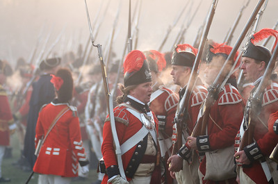 041513, Lexington, MA - British regular army reenactor officers demand to know who fired the first shot after driving the local militia off the town common during the reenactment of the Battle of Lexington. Photo by Ryan Hutton