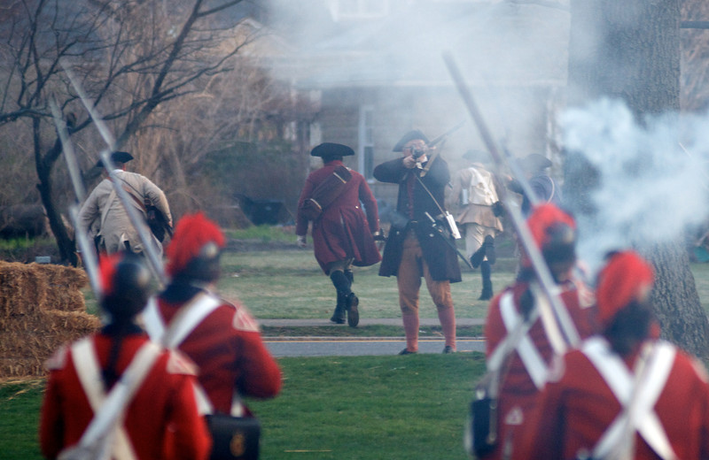 041513, Lexington, MA - British regular army reenactors drive the local militia off the town common during the reenactment of the Battle of Lexington. Photo by Ryan Hutton