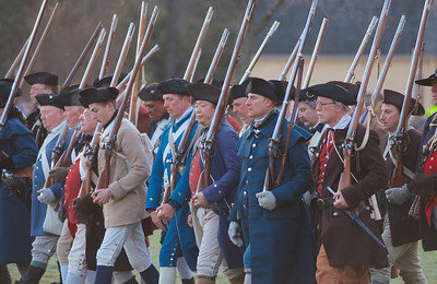 041513, Lexington, MA - Colonial Minutemen reenactors form ranks and march to the middle of the town common as the British arrive during the reenactment of the Battle of Lexington. Photo by Ryan Hutton