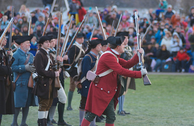 041513, Lexington, MA - A Colonial minuteman tells the British they will never take his weapon during the reenactment of the Battle of Lexington. Photo by Ryan Hutton