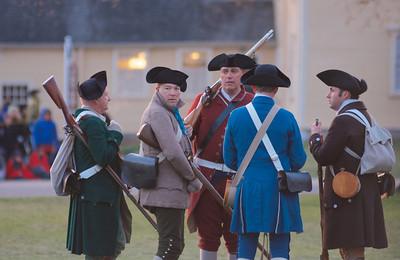 041513, Lexington, MA - Colonial Minutemen reenactors gather on the town common to await the British during the reenactment of the Battle of Lexington. Photo by Ryan Hutton