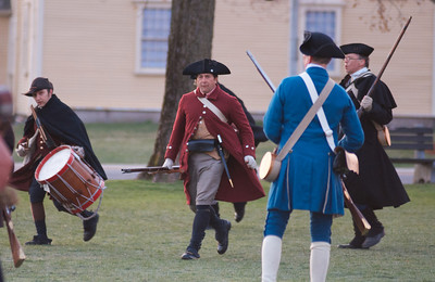 041513, Lexington, MA - Colonial Minutemen reenactors rally around Militia Capt. John Parker as he arrives on the town common to form his men into ranks during the reenactment of the Battle of Lexington. Photo by Ryan Hutton