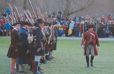 041513, Lexington, MA - Colonial Minutemen reenactors wait for Militia Capt. John Parker to give orders as they confront British regulars on the town common during the reenactment of the Battle of Lexington. Photo by Ryan Hutton