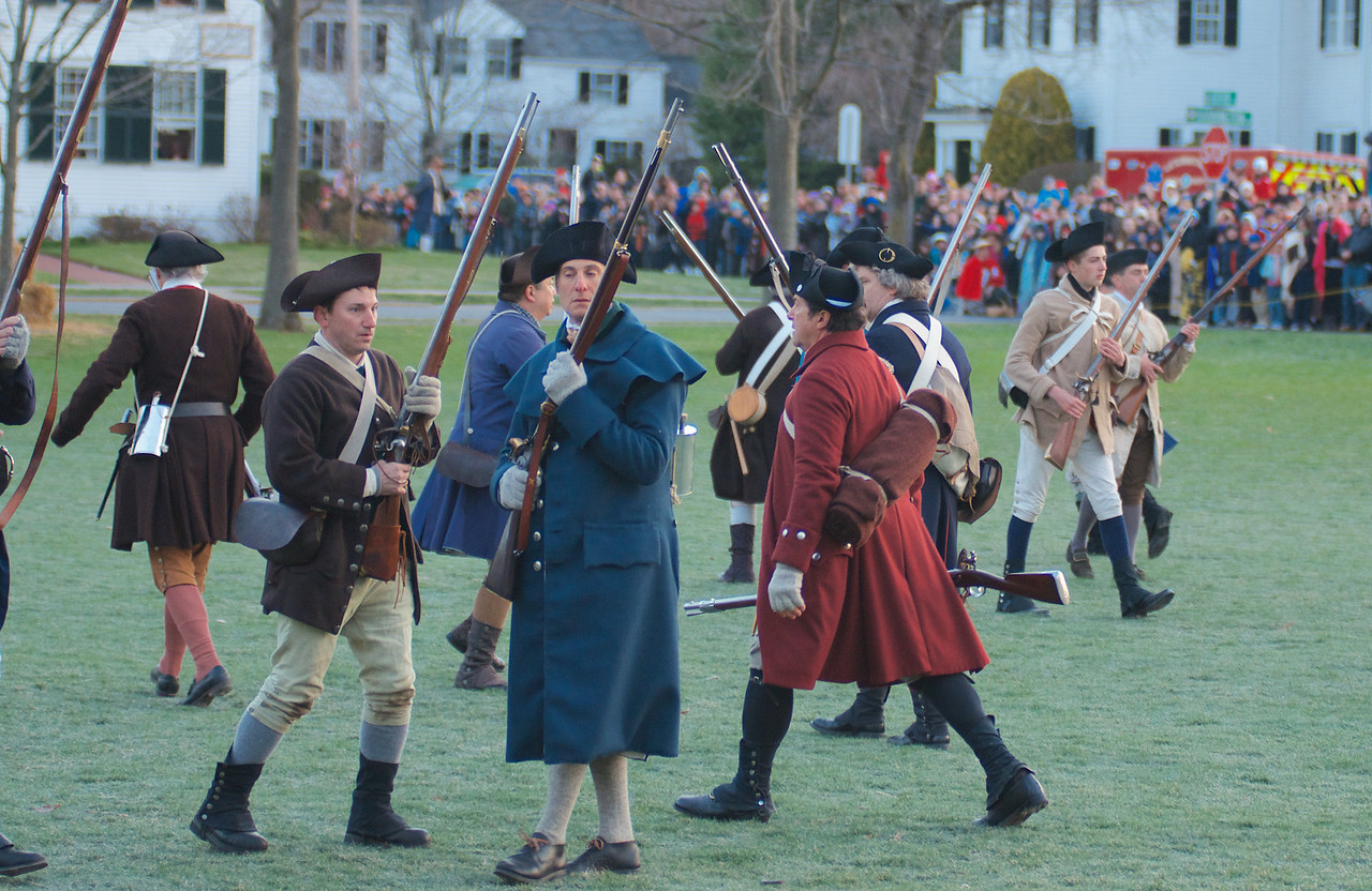 041513, Lexington, MA - Colonial Minutemen reenactors begin to fall back as the British advance during the reenactment of the Battle of Lexington. Photo by Ryan Hutton
