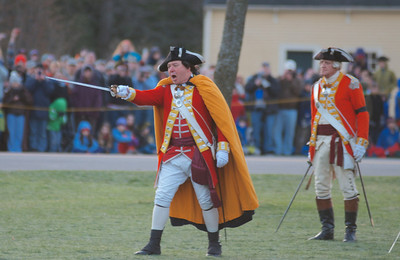 041513, Lexington, MA - British regular army reenactors order the minutemen to put down their weapons and disperse during the reenactment of the Battle of Lexington. Photo by Ryan Hutton