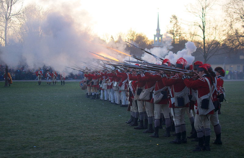 041513, Lexington, MA - British regular army reenactors fire a volley of shots to celebrate their victory during the reenactment of the Battle of Lexington. Photo by Ryan Hutton