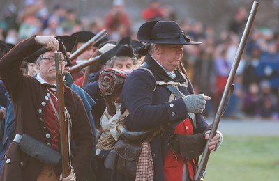 041513, Lexington, MA - Colonial Minutemen reenactors load their weapons as the British arrive during the reenactment of the Battle of Lexington. Photo by Ryan Hutton