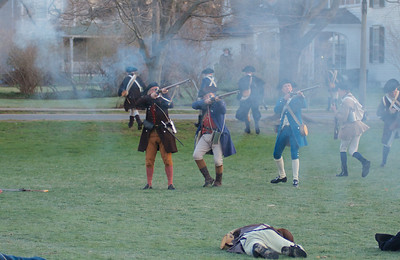 041513, Lexington, MA - Colonial Minutemen reenactors fire as they retreat during the reenactment of the Battle of Lexington. Photo by Ryan Hutton