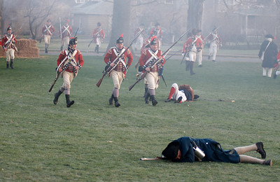 041513, Lexington, MA - British regular army reenactors reform ranks after driving the local militia off the town common during the reenactment of the Battle of Lexington. Photo by Ryan Hutton