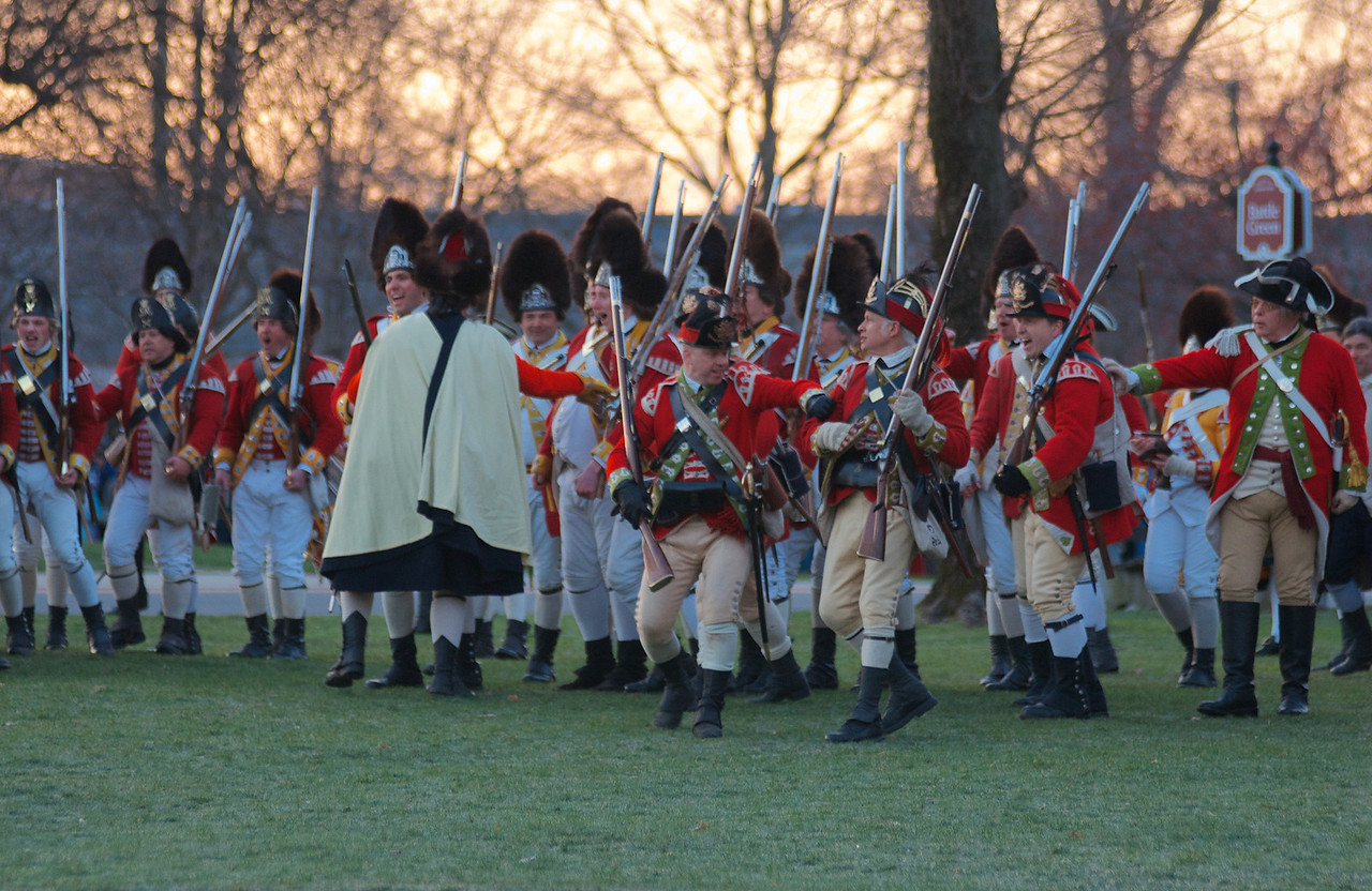 041513, Lexington, MA - British regular army reenactors shout to intimidate the Lexington militia during the reenactment of the Battle of Lexington. Photo by Ryan Hutton