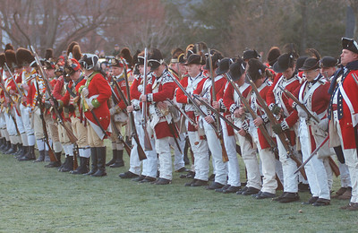 041513, Lexington, MA - British regular army reenactors load weapons and prepare to advance on the militia during the reenactment of the Battle of Lexington. Photo by Ryan Hutton