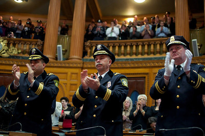Nov. 18, 2011, Boston, MA - Police officers and their famalies applaud for the the family of fallen Woburn police Officer John Maguire as they accept his posthumous Medal of Honor at the George L. Hanna Awards ceremony at the state house. Maguire was killed during a robbery last year. By Ryan Hutton