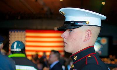 110912, Boston, MA - A full dress Marine stands guard over the Corps' 237th birthday cake at the Marine Corps Luncheon at the BCEC on Friday. Photo by Ryan Hutton