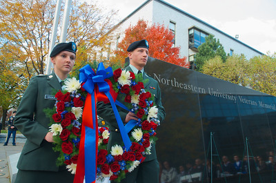 111212, Boston, MA -  Northeastern University ROTC Cadets Cpl. Grace Sroka '15, left, and Sgt. 1st Class Joseph Pelicano '14, right, prepare to lay a wreath  by the Northeastern University Veterans Memorial for the school's Korean War veterans during the school's Veterans Day celebration in the Neal F. Finnegan Plaza. Herald photo by Ryan Hutton