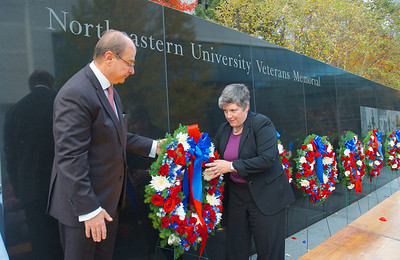 111212, Boston, MA -  Northeastern University President Jospeh E. Aoun and U.S. Secretary of Homeland Security Janet Napolitano place a wreath by the Northeastern University Veterans Memorial for the school's Operation Enduring Freedom veterans during the school's Veterans Day celebration in the Neal F. Finnegan Plaza. Herald photo by Ryan Hutton