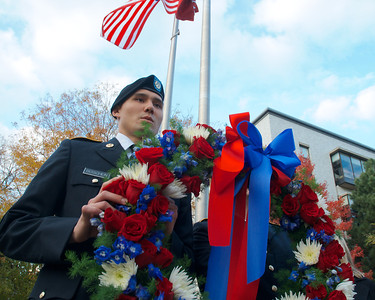 111212, Boston, MA -  Northeastern University ROTC Cadet Cpl. Makuya Boshen '15 prepares to lay a wreath   by the Northeastern University Veterans Memorial for the school's World War II veterans during the school's Veterans Day celebration in the Neal F. Finnegan Plaza. Herald photo by Ryan Hutton