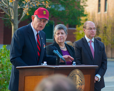 111212, Boston, MA -Retired U.S. Army Col. John R. Powers Jr. speaks at the Northeastern University's Veterans Day celebration in the Neal F. Finnegan Plaza by the Northeastern University Veterans Memorial. In the middle is U.S. Secretary of Homeland Security Janet Napolitano and on the right is Northeastern University President Joseph E. Aoun. Herald photo by Ryan Hutton