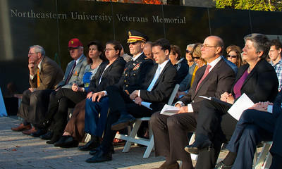 111212, Boston, MA - U.S. Secretary of Homeland Security Janet Napolitano, far right, and Northeastern University President Joseph E. Aoun, second from the right, listen during the school's Veterans Day celebration in the Neal F. Finnegan Plaza by the Northeastern University Veterans Memorial. Herald photo by Ryan Hutton