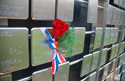 111212, Boston, MA -  A rose marks the name tag of Francis W. Curtin - a Northeastern grad who was killed in the Korean War - on the Northeastern University Veterans Memorial wall during the school's Veterans Day celebration in the Neal F. Finnegan Plaza. Herald photo by Ryan Hutton