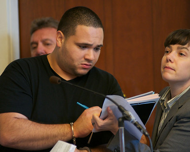 070912, Boston, MA - Rafael Vasquez, 28, of Canton signs a court document for his lawyer during his arraignment on drug charges in Boston Municipal Court on Monday. Herald photo by Ryan Hutton