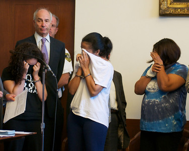 070912, Boston, MA - Maria Guzman, 28, of Jamaica Plain, left, Melissa Mejia, 28, of Hyde Park, center, and Martha Tejeda, 55, of Hyde Park, right, cover their faces during their joint arraignment on drug charges in Boston Municipal Court on Monday. Herald photo by Ryan Hutton