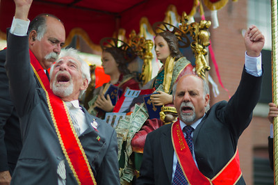 "090212, Lawrence, MA - St. Alifo Society Vice President Mike Fusco, right, and Society member Frank Vaccaro, left, shout ""Viva Sant' Alfio"" from the float carrying the statues of Saints Filadelfo, Alfio, Cirino as part of the three-day-long Feast of the Three Saints. Photo by Ryan Hutton"