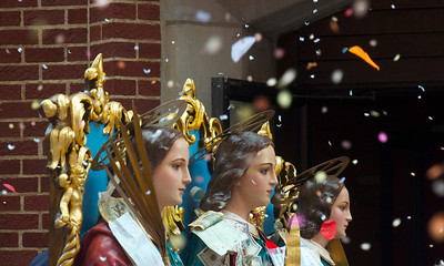 090212, Lawrence, MA - The statues of Saints Filadelfo, Alfio and Cirino are brought out of  Corpus Christi Parish on Essex Streer under a sea of confetti as part of the three-day-long Feast of the Three Saints. Photo by Ryan Hutton